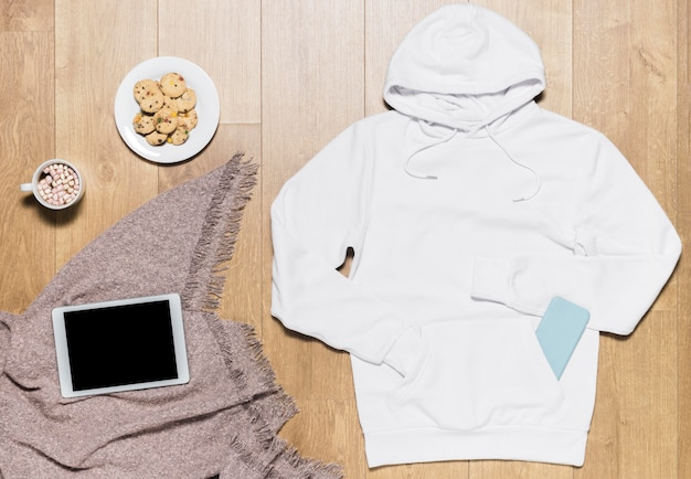 White hoodie with cookies plate beside