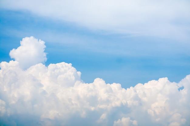 White huge heap cloud sunshine in summer blue sky soft cloud