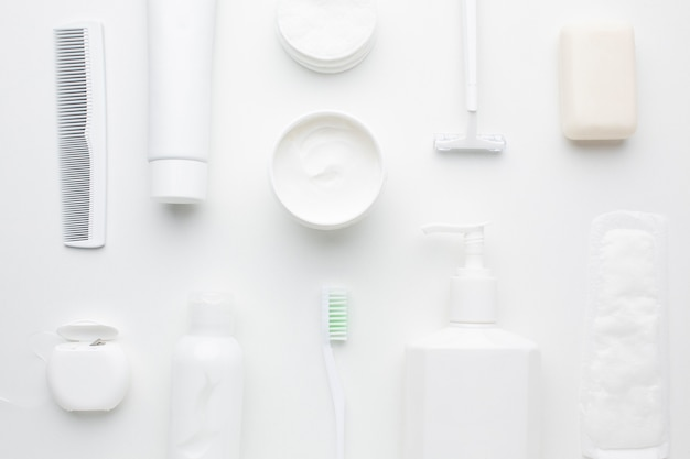 White hygiene products arrangement flat lay