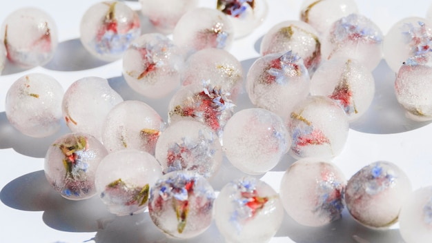 White ice spheres with flowers inside