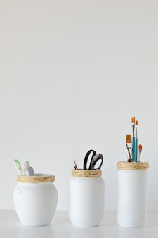 White jars craft made different uses on white background