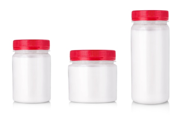 The white jars with red cap without label