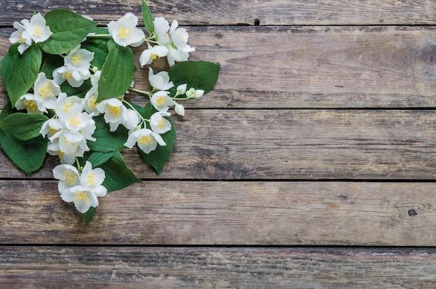 White jasmine flowers on rustic background