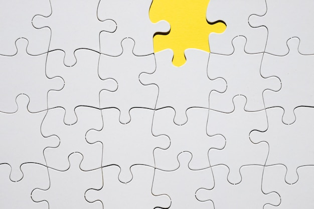 White jigsaw puzzle grid with missing puzzle piece