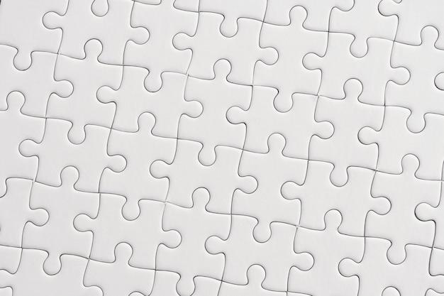 흰색 직소 퍼즐 패턴 배경입니다.