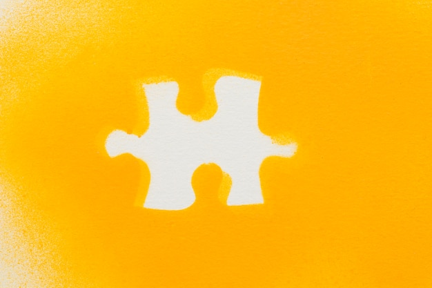 White jigsaw puzzle pieces on yellow background