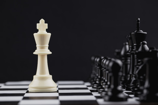 White king in chess game with concept for company strategy.