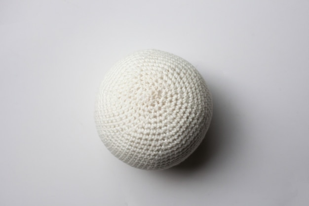 White knitted ball.