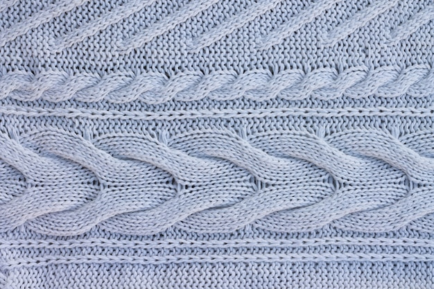 白いニットのセーターの背景。上面図。コピースペース