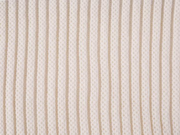 화이트 뜨개질 핑크 양모 질감 배경입니다.