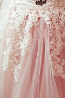 Of white lace fabric.