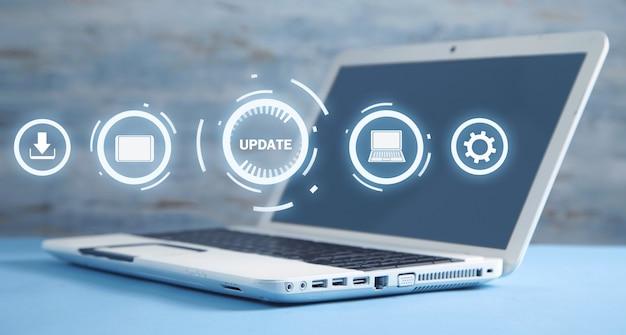 White laptop computer. update program. business, technology, internet concept
