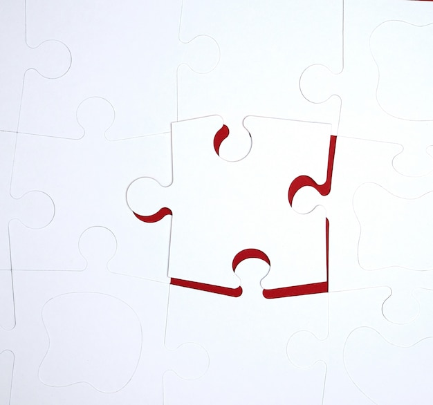 White large blank puzzles on red, top view