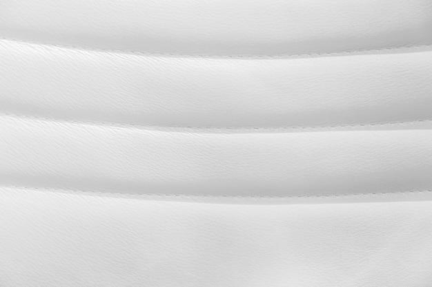 白い革とテクスチャの背景。