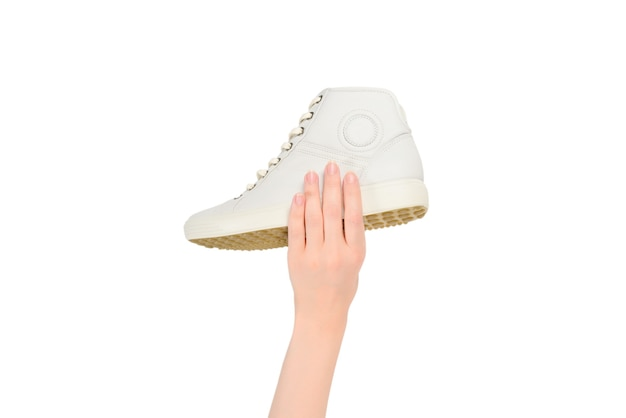 White leather shoes in woman hand isolated on white.