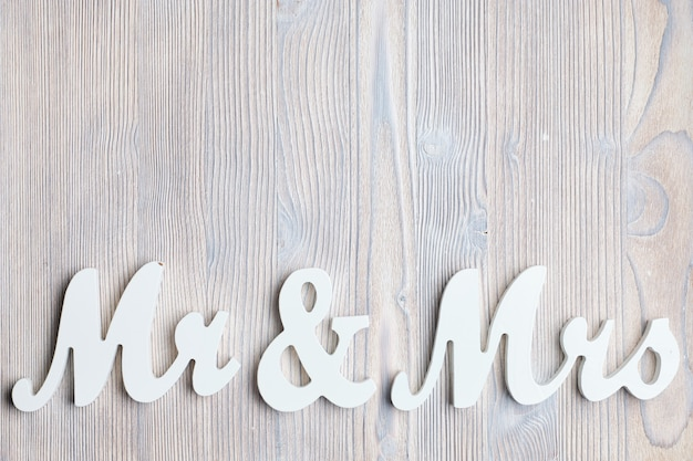White letters mr and vhk on a wooden space. top view. copy space.