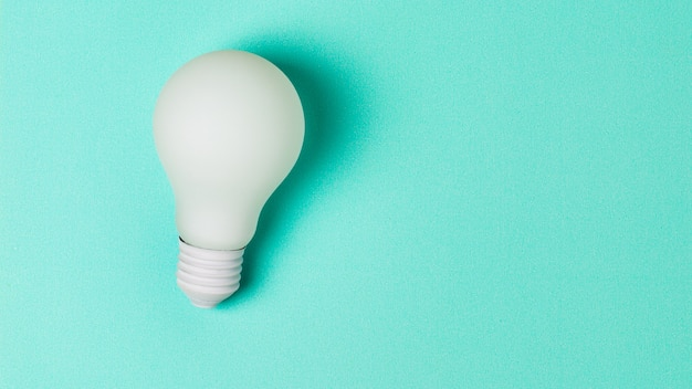 White light bulb on blue background