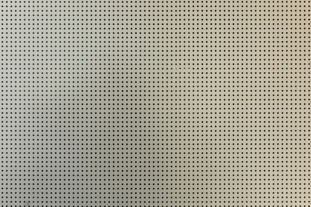 White light perforated plasterboard wall