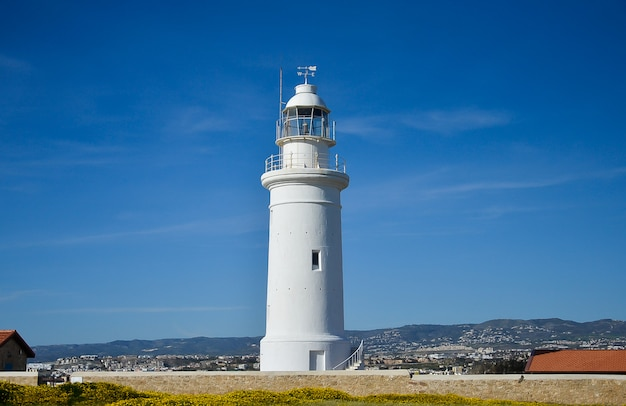 White lighthouse on blue sky