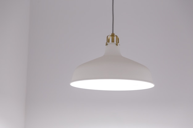 White lighting fixture with white wall background.