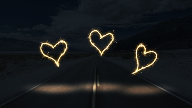 White lights forming hearts in the dark