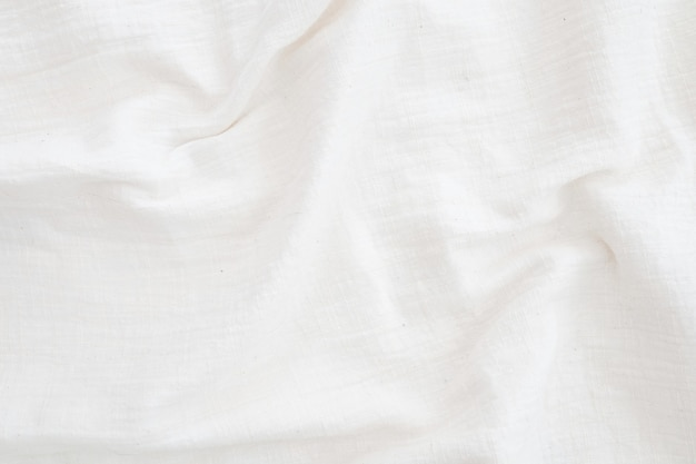 White linen canvas crumpled natural cotton fabric natural handmade linen top view background