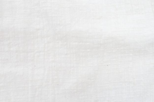 Белый льняной холст, мятый натуральный хлопок, натуральный лен ручной работы, вид сверху, фон