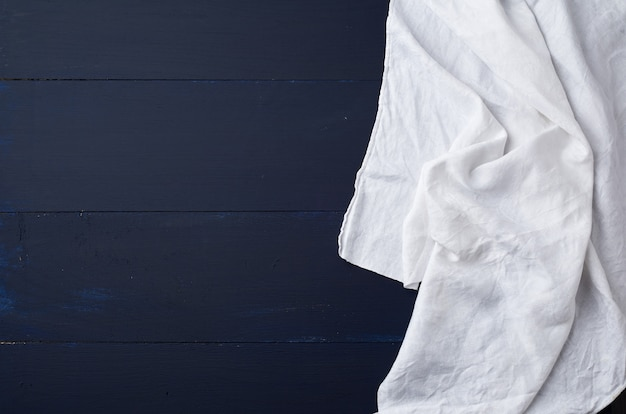White linen towel on blue wooden