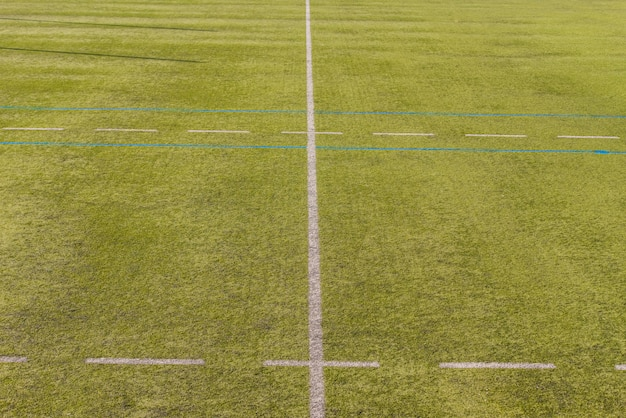 White lines on a playing field with artificial grass.