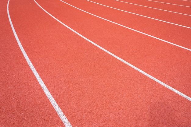 White lines of stadium and texture of running racetrack red rubber racetracks
