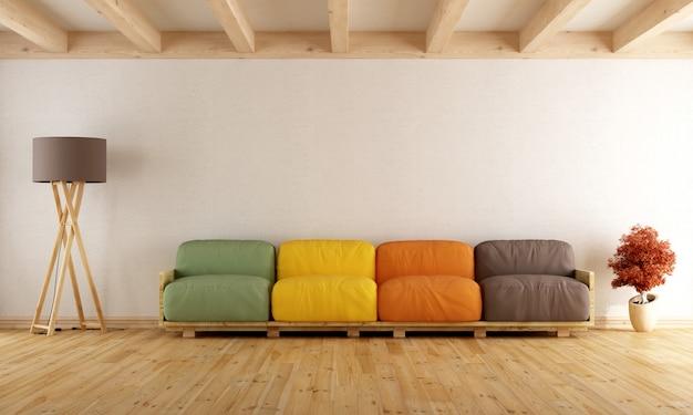 カラフルなパレットソファのある白いラウンジ