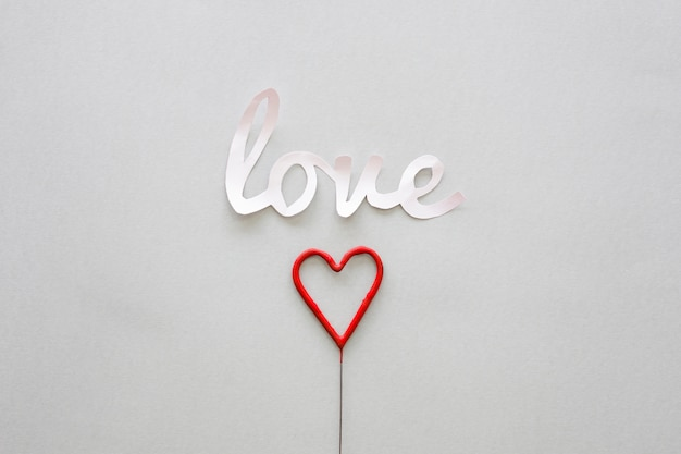 White love inscription with heart on stick