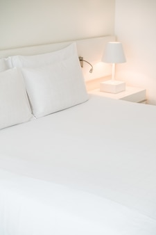 White made bed with nightlight