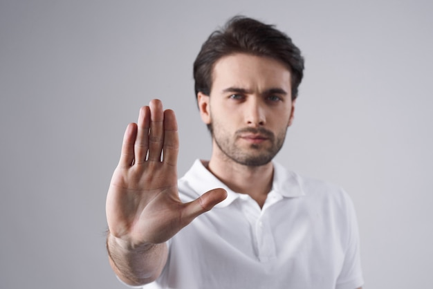 White man posing with hand gesture isolated.