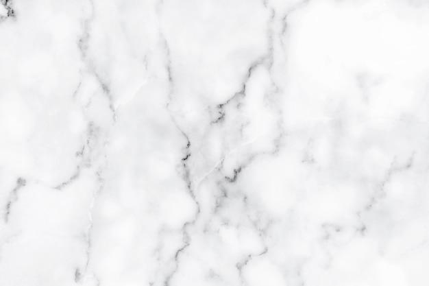 白い大理石の背景テクスチャ天然石パターンデザインアート作品の要約。