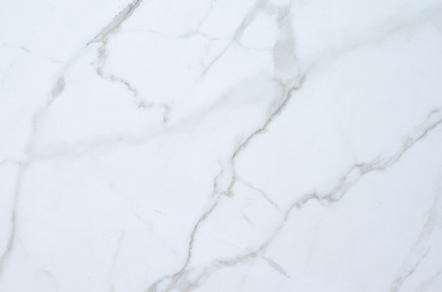 White marble background with streaks.