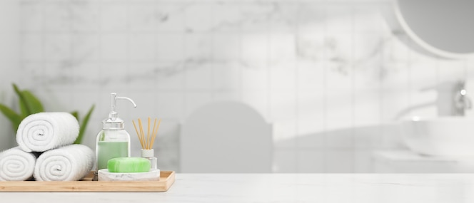 White marble table top with hand towel soap shampoo aroma diffuser and mockup space over bathroom