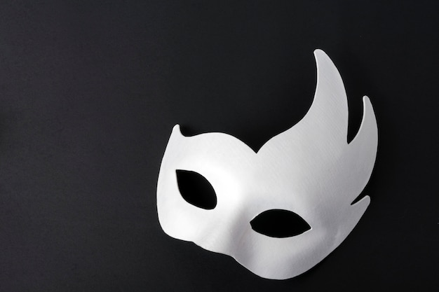 White mask on a black background. place for copyspace.