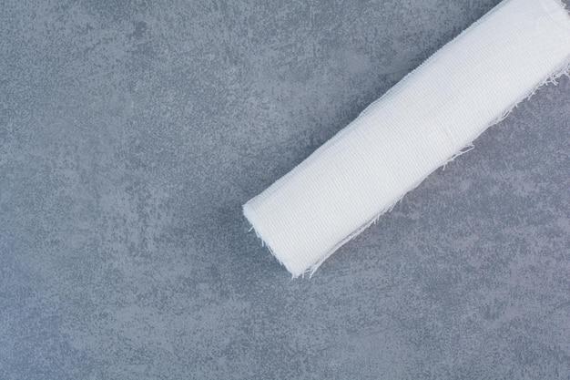 White medical bandage on marble surface