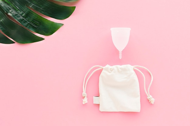 White menstrual cup on pink