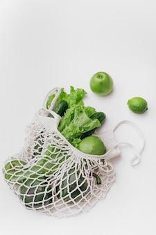 White mesh bag vegetables fruits isolated