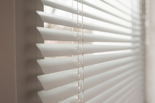 White metal blinds in the office