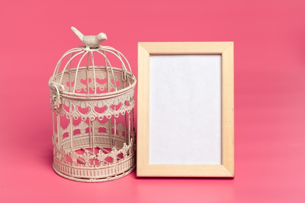 White metal decorative cages on colored pink