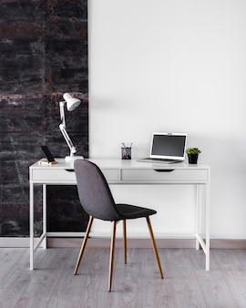 White metallic desk concept with lamp