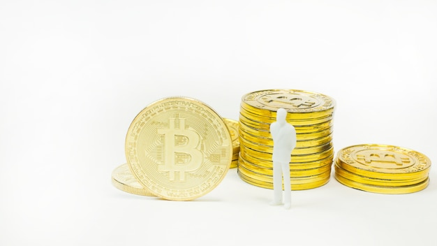 White miniature and gold coin bitcoin abstract image close up background
