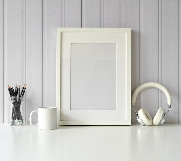 White mock up frame and gadget on white table.