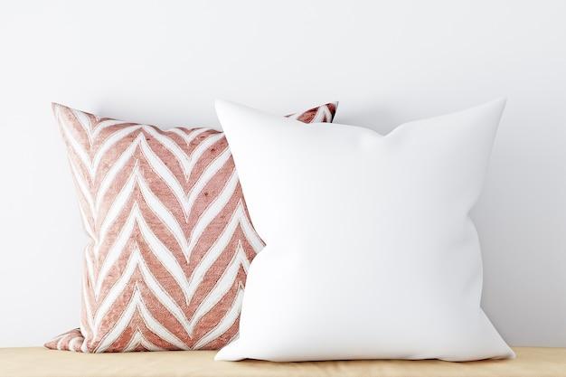 装飾的な枕の背景に白いモックアップ枕