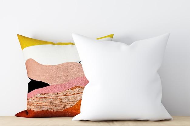 別の装飾的な枕の背景に白いモックアップ枕