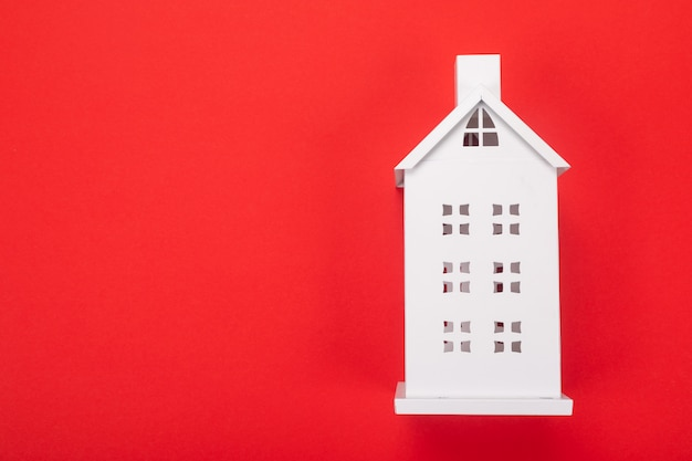 White model of the house on red