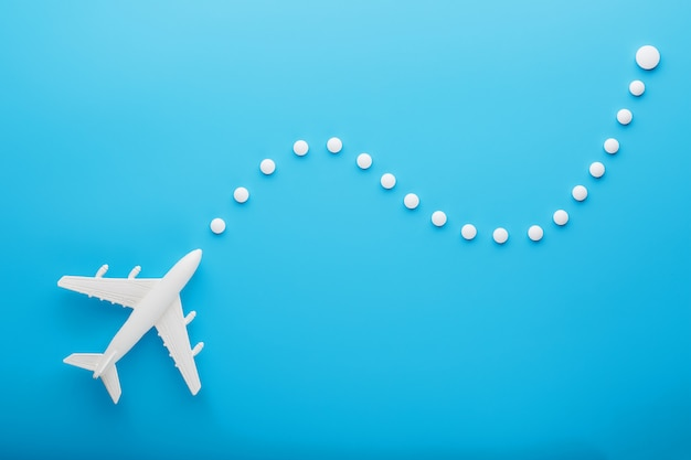 White model of a passenger plane with dotted trajectory points isolated on background